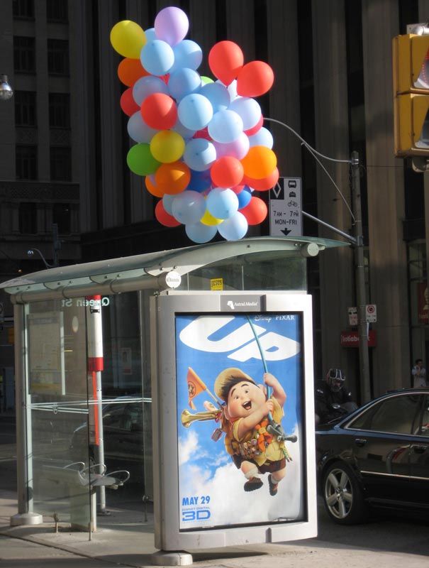 bus stop ads up balloons